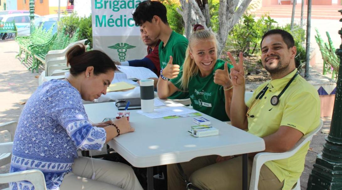 High school volunteers take a rest during a medical outreach in Mexico.